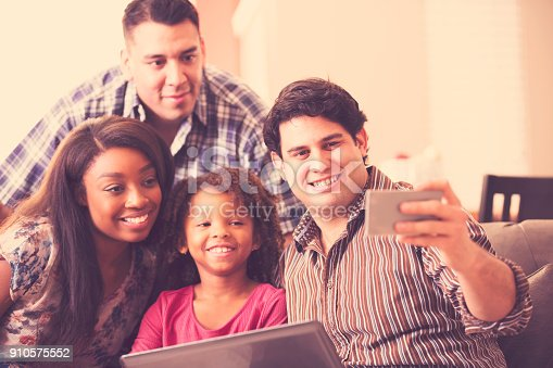 istock Multi-ethnic family having fun at home. 910575552