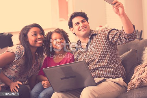 istock Multi-ethnic family having fun at home. 910575618