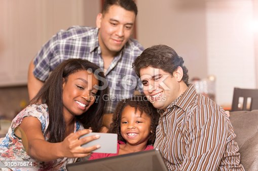 istock Multi-ethnic family having fun at home. 910575674