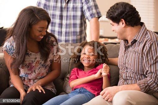 istock Multi-ethnic family having fun at home. 975205040