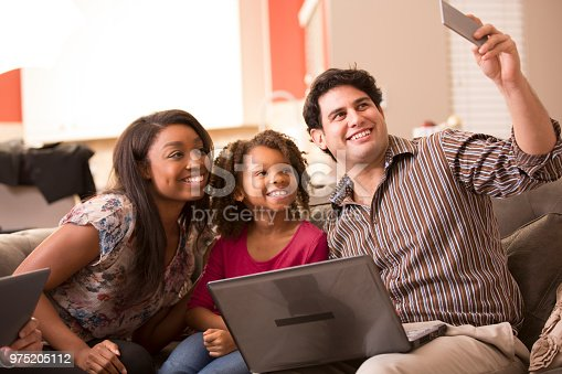 istock Multi-ethnic family having fun at home. 975205112