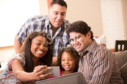 istock Multi-ethnic family having fun at home. 975205164
