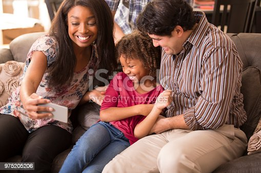 istock Multi-ethnic family having fun at home. 975205206