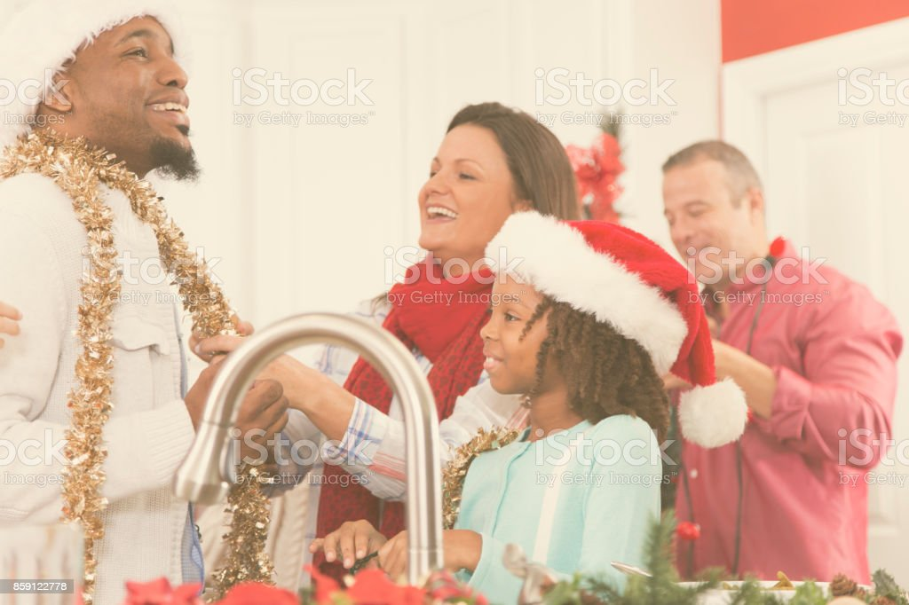 Multi-ethnic group of family members including senior adults,...