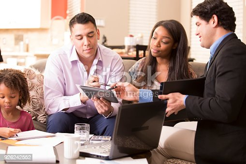 994164754 istock photo Multi-ethnic family meets with financial advisor. 926242552