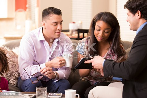 994164754 istock photo Multi-ethnic family meets with financial advisor. 926243516