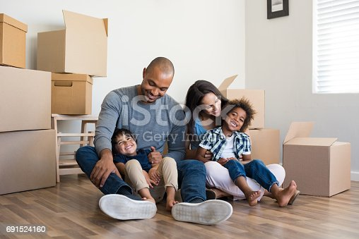 istock Multiethnic family moving home 691524160