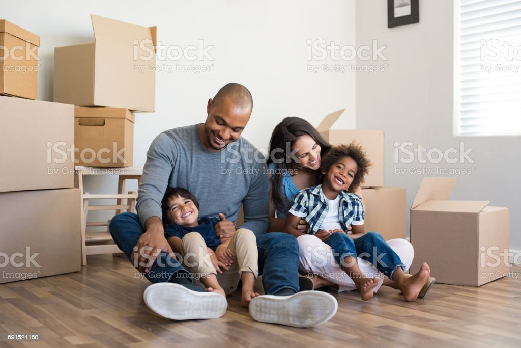 Multiethnic family moving home stock photo