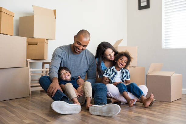 multiethnic family moving home - house hunting stock photos and pictures