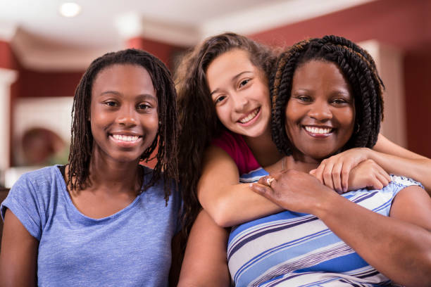 Multi-ethnic, foster care family at home. stock photo