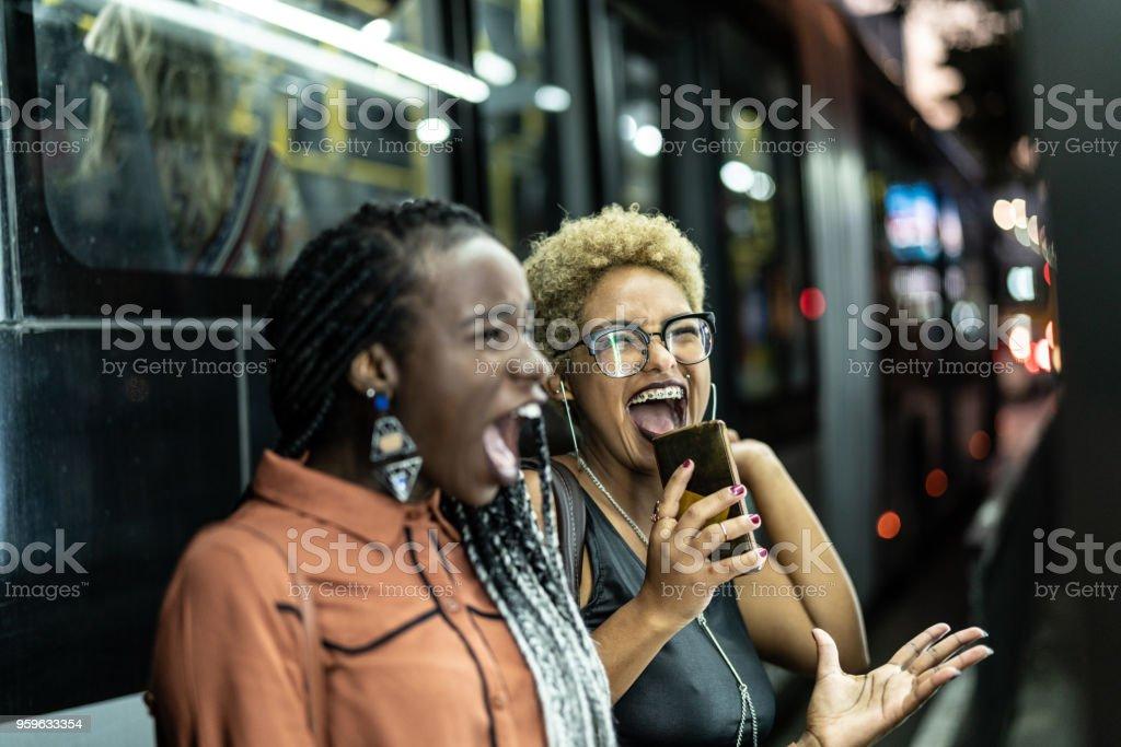 Multi-Ethnic Friends Celebrating Good News stock photo