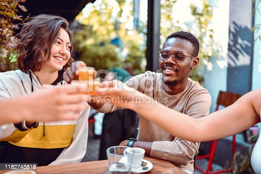 Multiethnic Friends Having A Celebratory Cocktail Toast