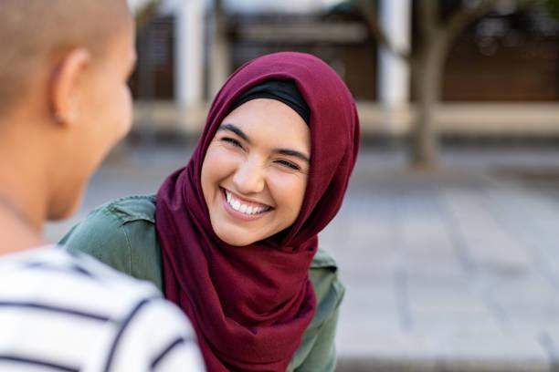 multiethnic friends in conversation - хиджаб стоковые фото и изображения