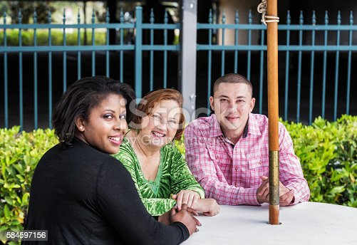 istock Multi-Ethnic Friends Meeting Together At Outdoors Picnic Table 584597156