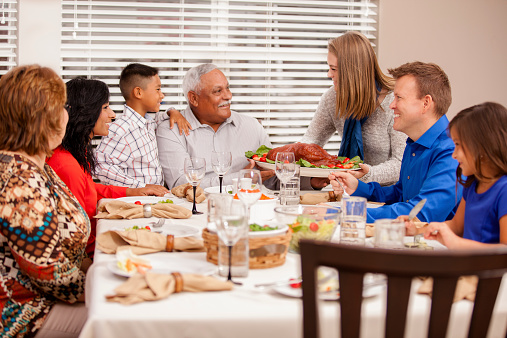 Multiethnic Generation Family Enjoys Thanksgiving Dinner Stock Photo - Download Image Now