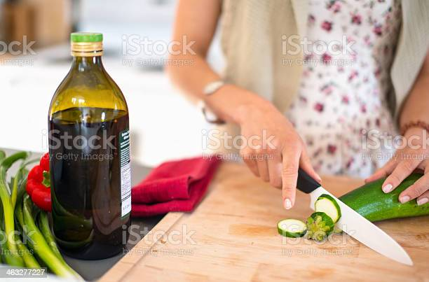 Multiethnic Girl Preparing Food In The Kitchen Stock Photo - Download Image Now