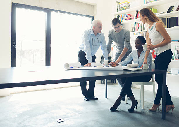 Multi-Ethnic Group of architects Have Meeting. stock photo