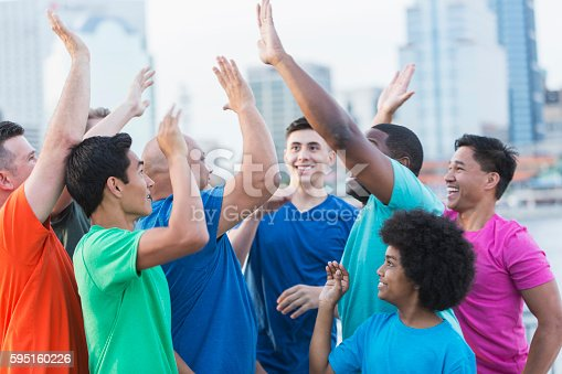1091098220 istock photo Multi-ethnic group of boys and men, high fives 595160226