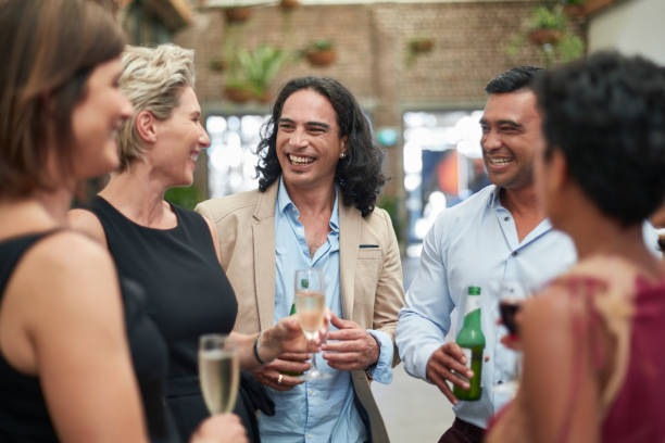 multi-ethnic group of business people having drinks in a convention - happy hour stock photos and pictures