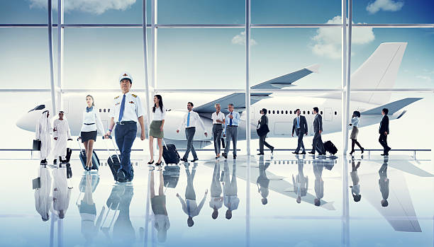 Multiethnic Group of Business People with Airplane ***NOTE TO INSPECTOR: These planes are our own generic design, they do not infringe on any copyrighted designs. cabin crew stock pictures, royalty-free photos & images
