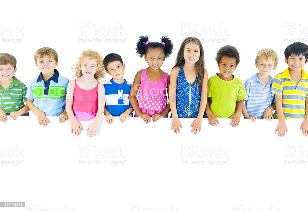 Multi-ethnic group of children holding board royalty-free stock photo