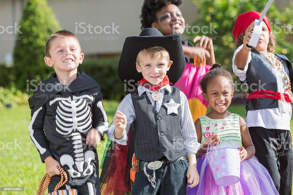 Multiethnic Group Of Children In Halloween Costumes Stock