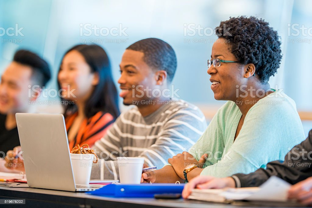 A multi-ethnic group of college students are sitting bildbanksfoto