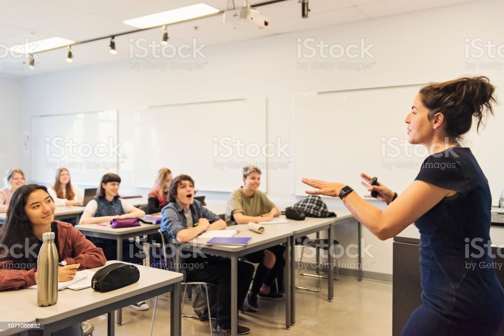 Multi-ethnic group of College students in classroom. stock photo
