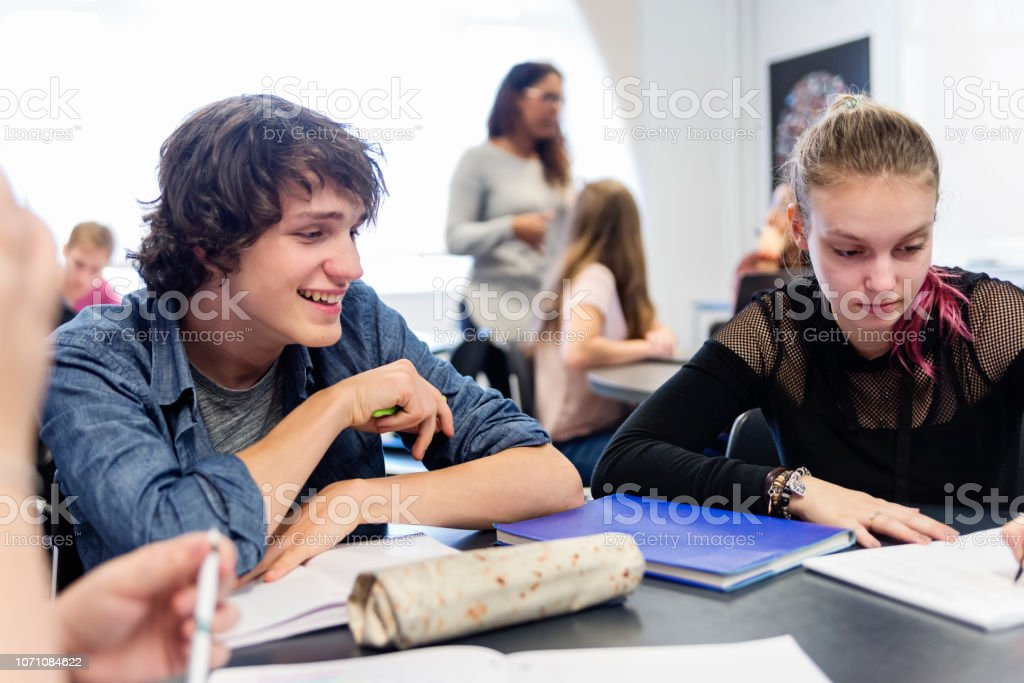 Multi-ethnic group of College students working in team in classroom. stock photo