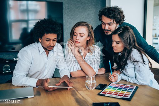 842214506 istock photo Multi-ethnic group of  designers discussing during a meeting. 1212431171