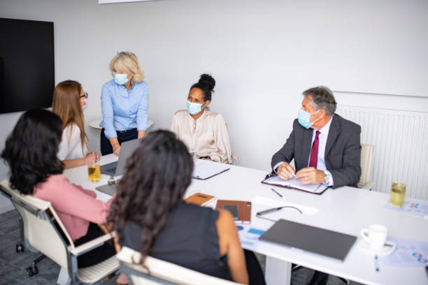 Multi-Ethnic Group of Executives Meeting in Time of COVID-19 stock photo