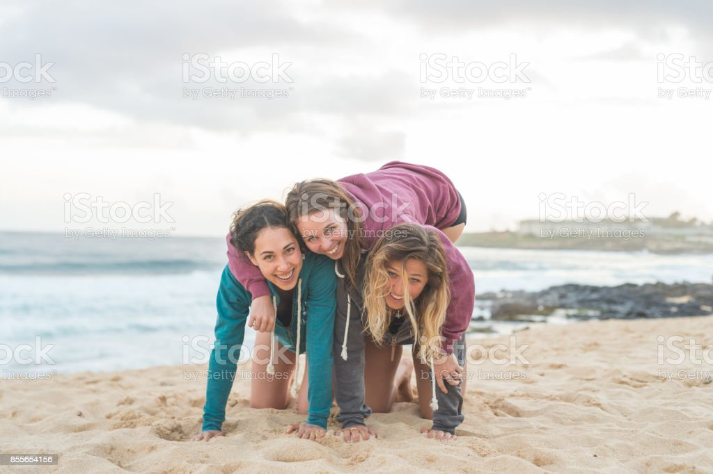 Multi-ethnic group of female friends having fun on tropical beach stock photo