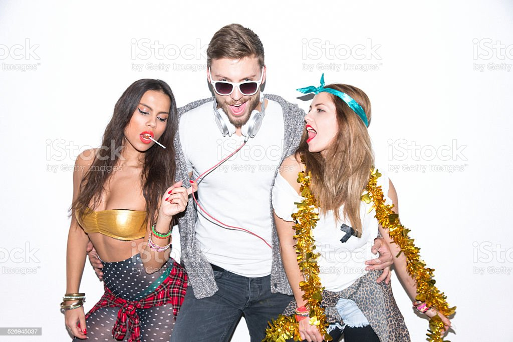 Multi-ethnic group of friends having fun on party stock photo