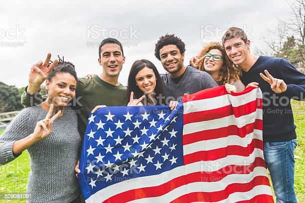Multiethnic group of friends with united states flag picture id529081091?b=1&k=6&m=529081091&s=612x612&h=phiqg9g5 bmbjp2tmz4gjmickwe7ezg7lq5u0j8v03o=