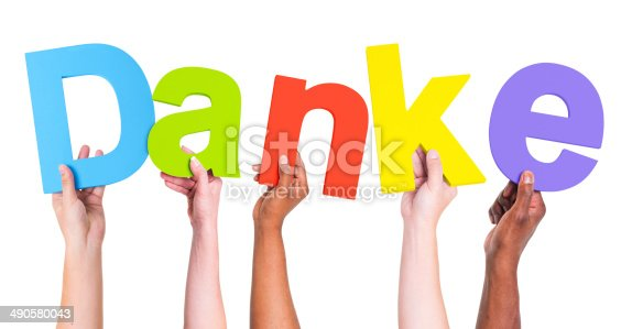 istock Multiethnic Group of Hands Holding Word Danke 490580043