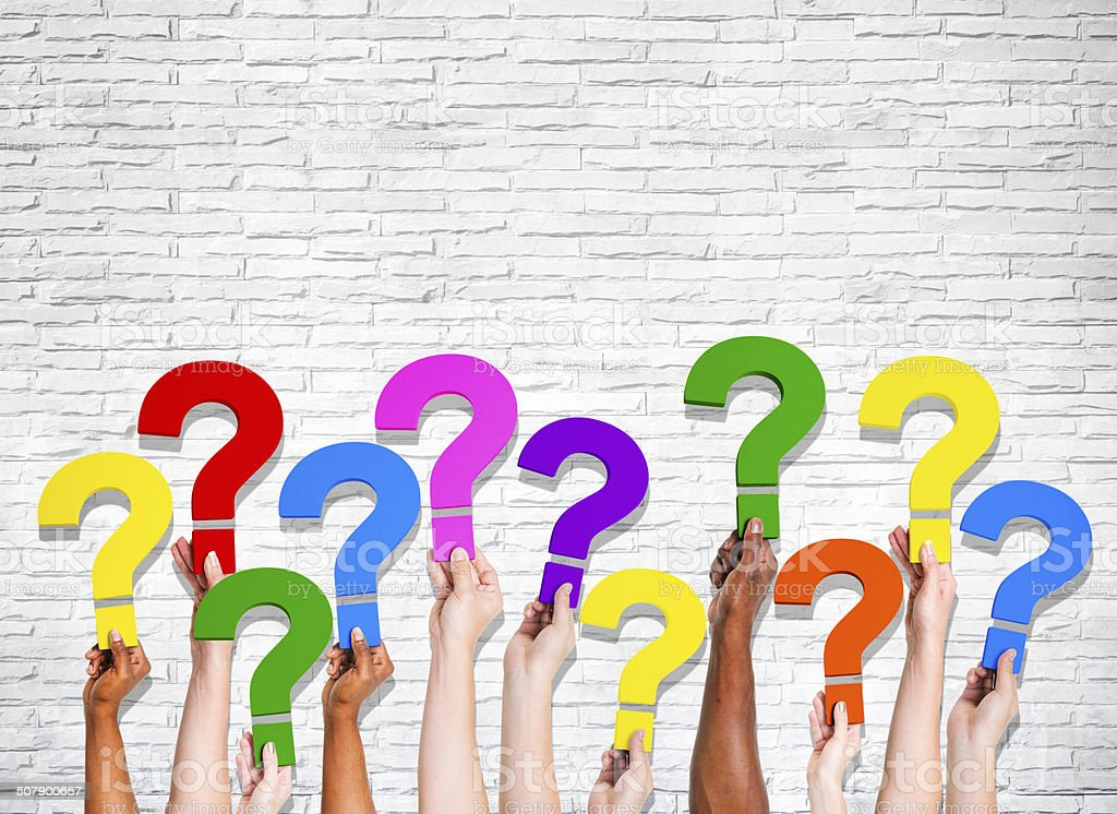 Multiethnic Group of Human Hands Holding Question Marks stock photo