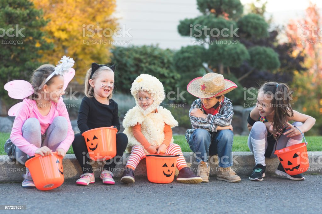 Multiethnic group of kids trick or treating stock photo