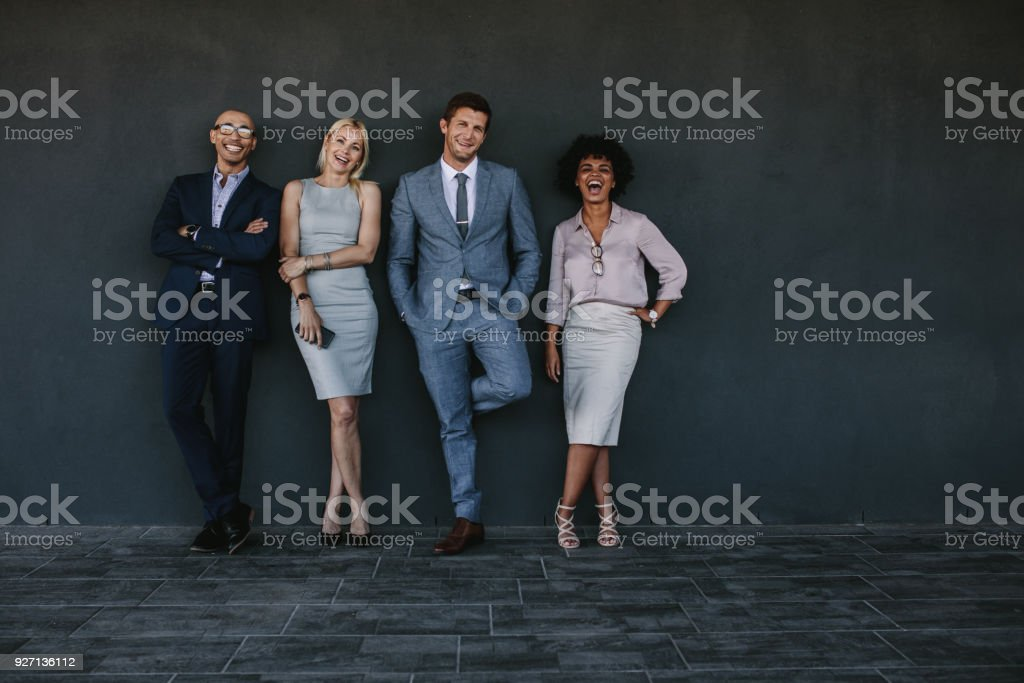 Full length portrait of multi-ethnic group of business colleagues...