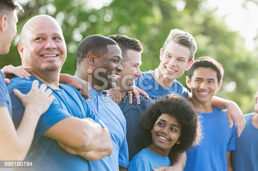 1091098220 istock photo Multi-ethnic group of men and sons in blue shirts 595160194