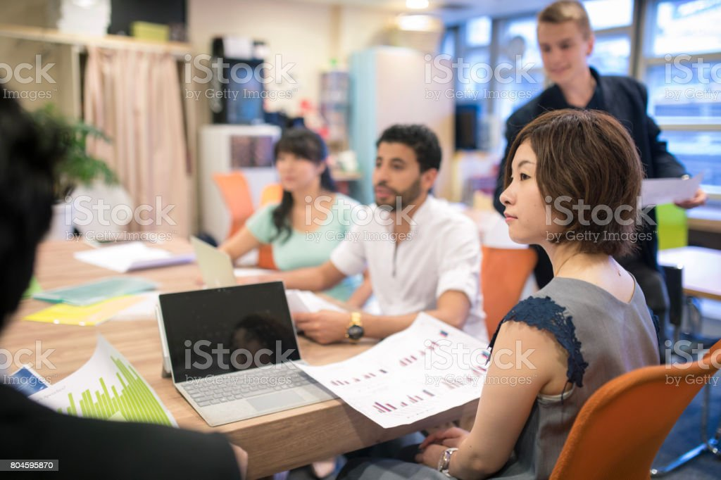 Multi-ethnic group of people having discussion stock photo
