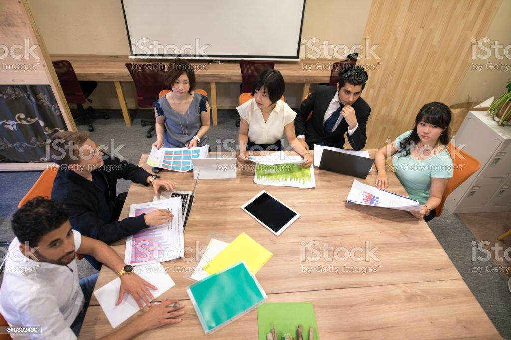 Multi-ethnic group of people having team meeting stock photo