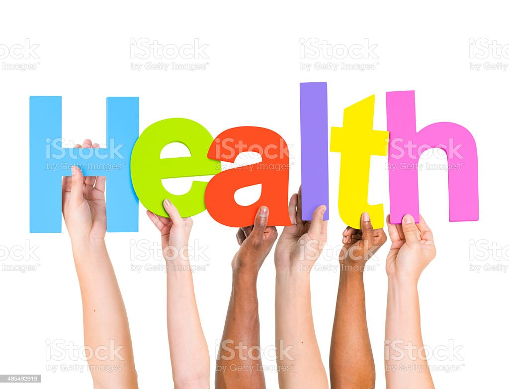 Multi-Ethnic Group of People Holding Letters To Form A Health stock photo