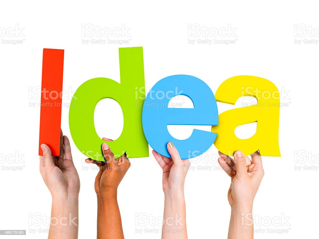 Multi-Ethnic Group Of People Holding The Word Idea royalty-free stock photo