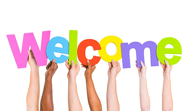 Multi-Ethnic Group Of People Holding The Word Welcome  welcome sign stock pictures, royalty-free photos & images