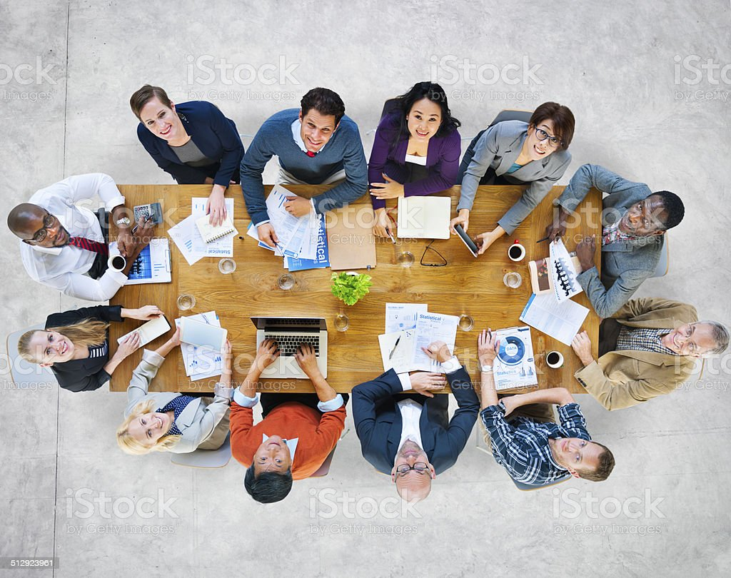 Multiethnic Group of People in a Meeting Looking Up stock photo