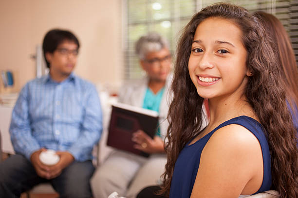 multi-ethnic group of people in counseling session with therapist. - teen counseling stock photos and pictures