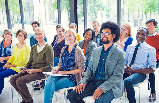 multiethnic group of people in seminar - casual clothing stock photos and pictures