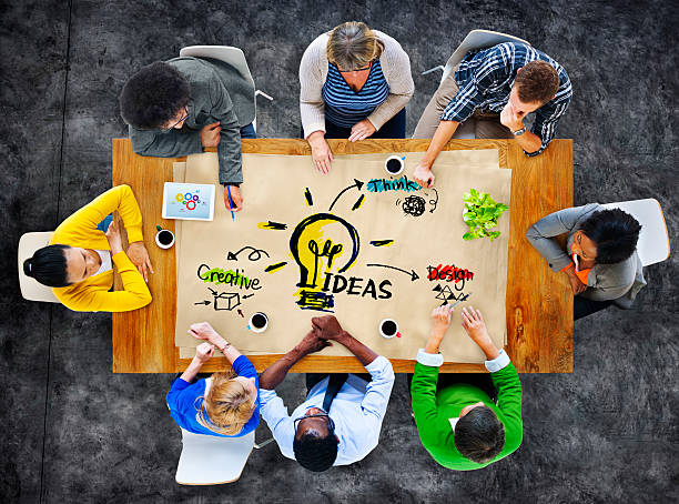 multiethnic group of people planning ideas - business symbols stock photos and pictures