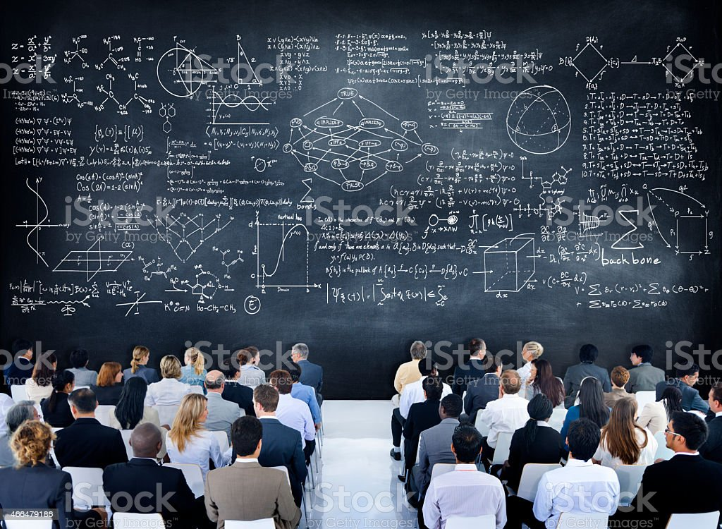 Multiethnic Group of People with Formula on Chalkboard stock photo