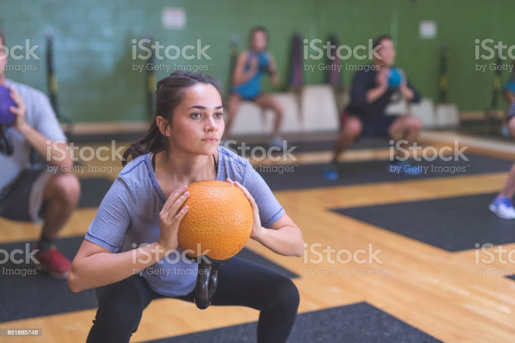 Multi-ethnic group of people working out  at fitness facility stock photo